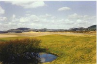 12th green and the Galloway hills