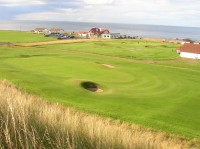 2nd green, clubhouse behind, dunbar, finest courses